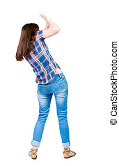 back view of woman protects hands from what is falling from above