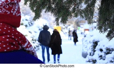 Back view of woman strolling in winter park - Back view of ...