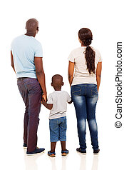 back view of young african family holding hands isolated on...
