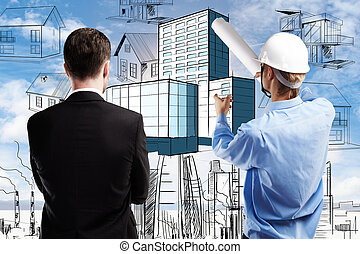 Construction concept - Back view of young businessman and ...