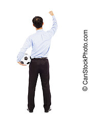 Back view of young businessman hold a ball