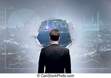 Vision concept - Back view of young businessman looking at...