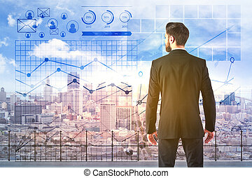 Finance concept - Back view of young businessman standing on...
