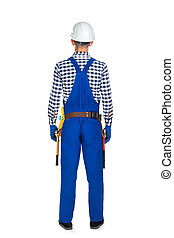 Back view of young construction worker in uniform and tool belt