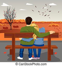 Back view of young couple sitting together on bench outdoors in autumn