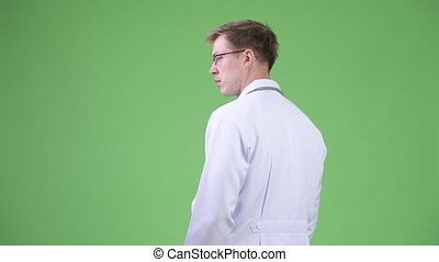 Back View Of Young Man Doctor Turning