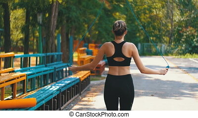 Back view on Young Athlete Woman in Comfortable Sport Outfit...