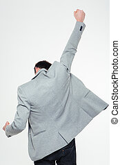Back view portrait of a businessman celebrating his success