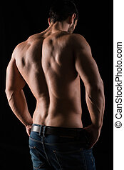 Back view portrait of a man with muscular body