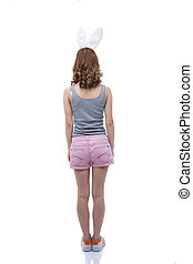 Back view portrait of a woman with rabbit ears over white background