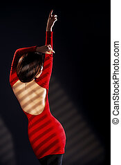 back view - Fashion shot of a sexual woman in elegant red...