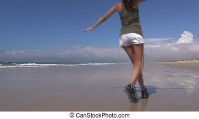 back woman flying on beach