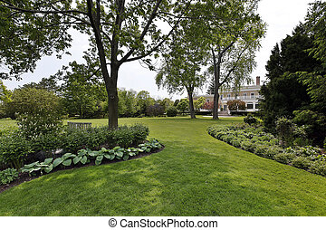 Back yard of luxury home - Rear view of grounds and luxury ...