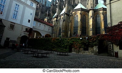 Back yard view with tourists group of prague cathedral