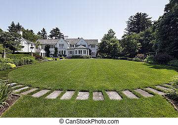 Back yard of luxury home with stone path