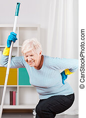 Backache during cleaning up - Elderly woman and terrible...