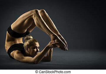 Backbend Gymnastics, Woman Gymnast Flexible Body, Acrobat Standing in Back Bend Pose on Black Background