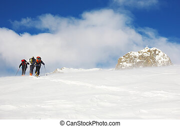 Backcountry skiers - A group of backcountry skiers walks up...