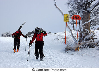 Backcountry skiing - Two skiers hiking to find powder