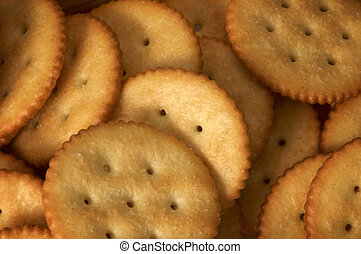 backdrop of pile of golden round butter crackers