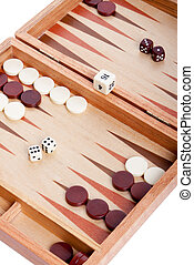 Backgammon game in front of white background