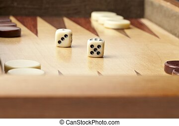 backgammon table with dice and chips