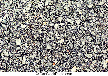 close up of gray macadam stones on ground - background and ...