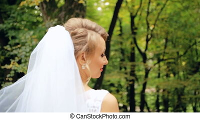 Background behind the back of the bride in the park is spinning shot in slow motion  close up