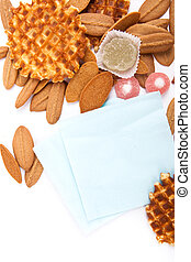 background biscuits, waffles, fruit jelly and fork and napkin isolated on white background