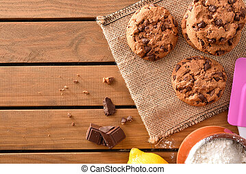 Background biscuits with chocolate chips on wooden slatted table top