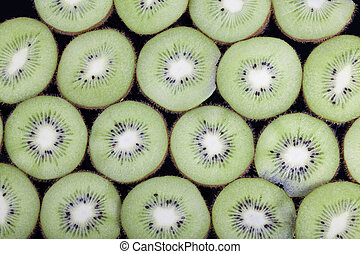background black kiwi slices
