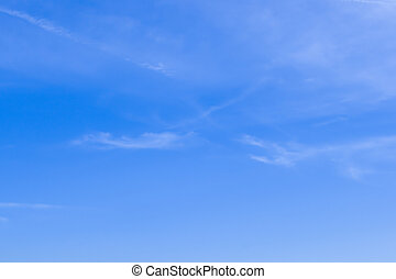 Background blue sky - Blue sky with wisps of clouds for use...
