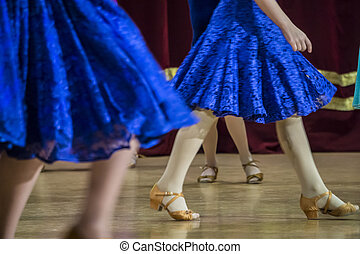 Background - children's tournament on ballroom dances - feet on the floor