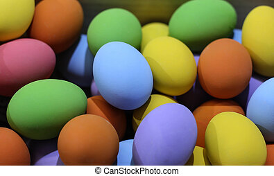 Background colorful easter eggs in the wooden box