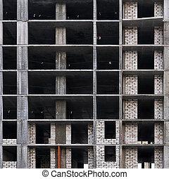 background - facade of a building under construction