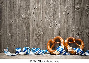 Background for Oktoberfest - Bavarian pretzels with ribbon...