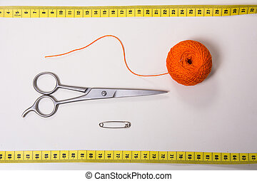 Background for tailor orange thread, measuring tape and scissors