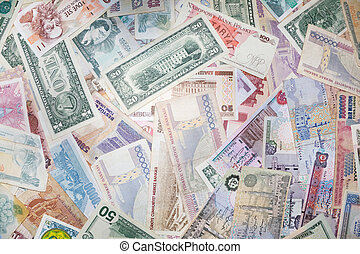 Background from banknotes of various monetary currencies