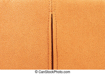 Background from brown suede close up, zipper in the middle