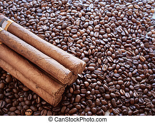Background from coffee grains with the Cuban cigars