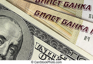 Background from dollars and rubles, close up