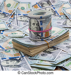 Background from dollars. Notes of one hundred American dollars are scattered across the background.