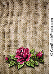 background from fabric with the embroidered rose