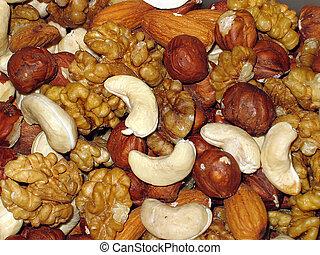 Background from nuts . Nuts. Hazel. Walnuts.