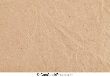 background from sheet of crumpled kraft paper close up