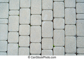 background grey stone pavement. road paved with cobbles. texture of bricks.