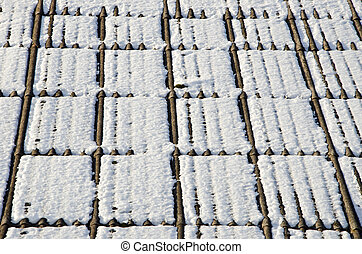 Background house slate roof snow winter. Poisonous