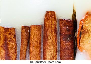 Detailed closeup of cinnamon in candle wax