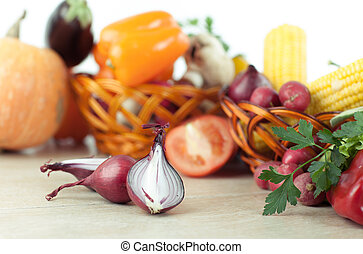background image of fresh vegetables on a wooden table