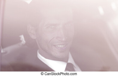 background image of the businessman in the car